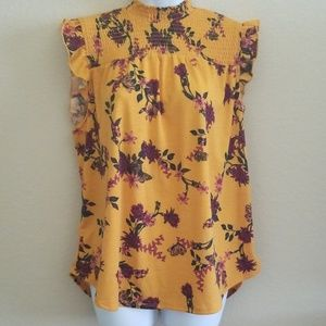 NWOT Floral top with free earrings to match!